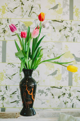vase with tulips in spring backgroud