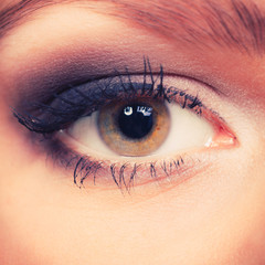 Glamorous woman with elegant eye make up.