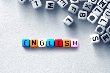 colorful english word cube on white paper background ,English language learning concept