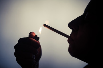Woman lighting up a cigarette