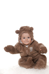 baby boy,dressed in furry teddy bear carnival suit, isolated on white background