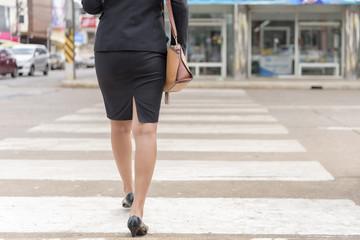 Office girl. young woman Walk across the street. Crosswalk