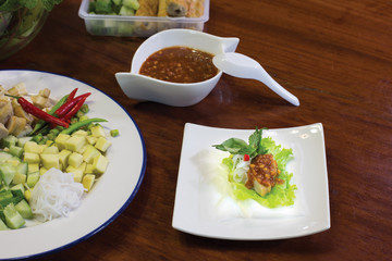 Nam Neung , Vietnamese food in white dish and sweet sauce with ingredients