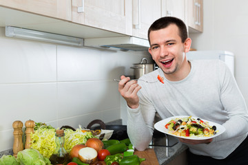Happy handsome man holding plate