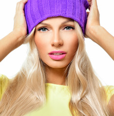 Fashion pretty carefree  blonde woman wearing a colorful violet hat