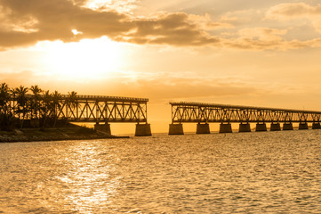 Remains of Bahia Honda railroad bridge in Florida Keys at sunset