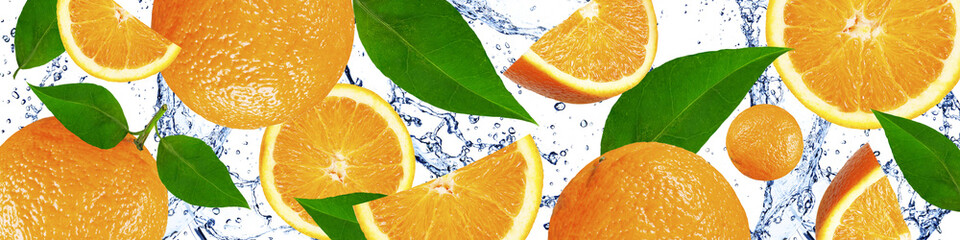 Oranges with green leaves in the water
