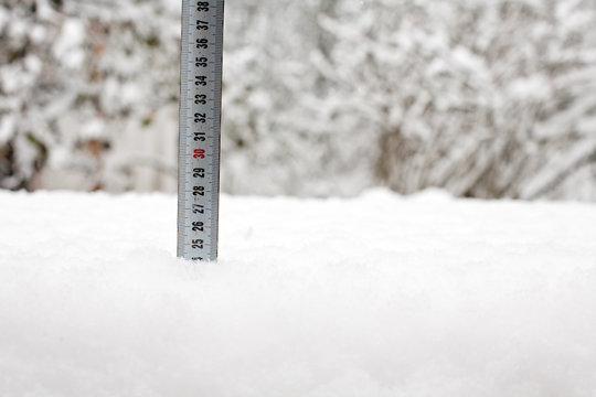 tape measure in snow