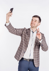 young business man taking selfie smiling. portrait isolated over white studio background.