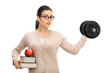Young female teacher lifting a dumbbell