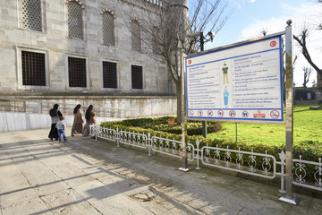 ISTANBUL, TURKEY - FEBRUARY 12, 2014: Three women and a child arriving at the Blue Mosque at Istanbul in Turkey.