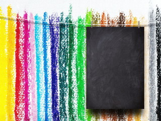 Blank blackboard frame against multicolored pastel background