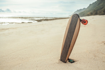 skateboard on the beach at sunset, youth and freedom concept