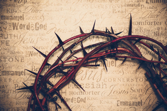 Crown of thorns with Jesus names and attributes in the background.