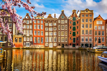 Fotobehang Amsterdam Traditional old buildings in Amsterdam at spring, the Netherlands