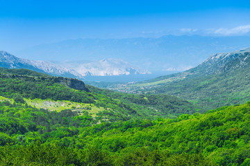 Wonderful romantic summer afternoon landscape panorama. Green, emerald valley of in the canyon plateau. Deciduous forest. Baska on the island of Krk. Croatia. Europe.