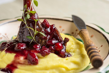 Roasted Duck Leg with Mashed Potatoes, Apples and Red Currants in Red Wine Sauce