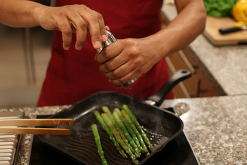 Cooking Asparagus, adding pepper
