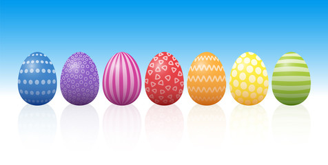 Easter eggs with different patterns and rainbow colors. Isolated three-dimensional vector illustration on blue to white background.