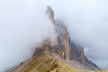 Tre Cime di Lavaredo in beautiful surroundings in the Dolomites at foggy weather   (Drei Zinnen)