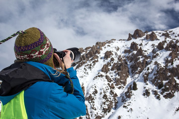 Nature Photography Concept. Professional photographer takes photos of rock peak. Winter landscape.