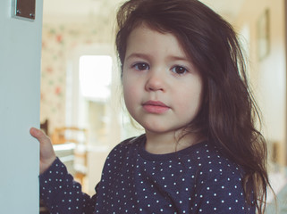 Beautiful toddler girl with long hair looking