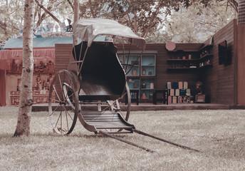 Chinese rickshaw / View of traditional Chinese rickshaw on the ground.