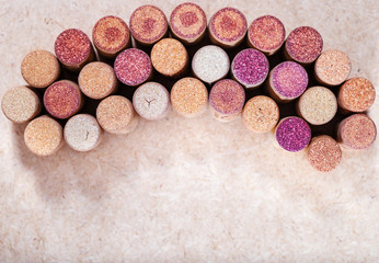 Wine crocks background horizontal. Copy space place for your text. Used wine stoppers. Color change of wine corks. Mix of corks.