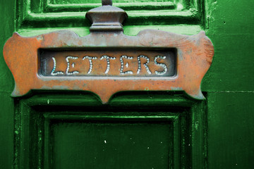 Letters Slot on Green Door