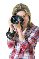 Girl photographer taking  picture in the studio, portrait of  girl with a camera on  white background. Space for text