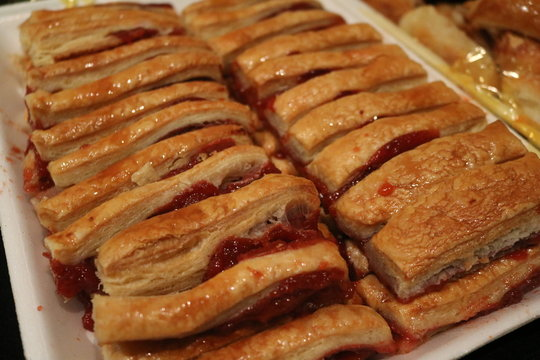a tray full of guava pastries