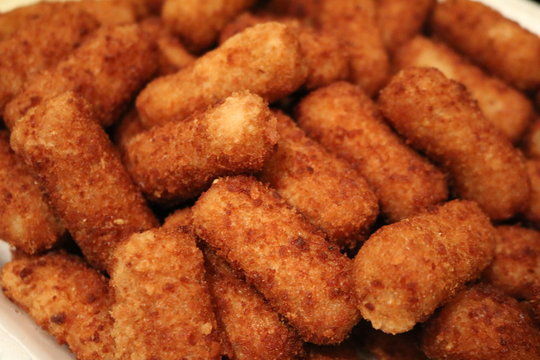 a platter of fried croquettes