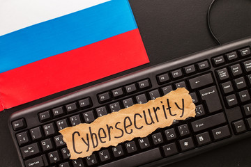 CYBERSECURITY,  inscription on torn  white paper  sheet