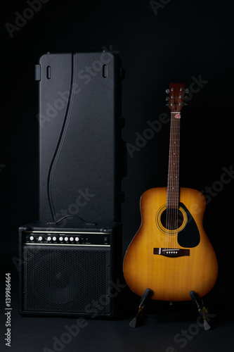 Acoustic Guitar Black Hard Case And Classic Amplifier On A Dark