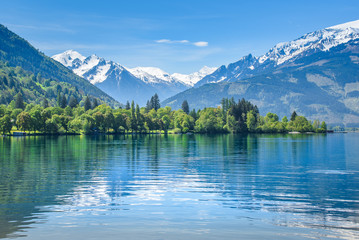 Reflection of a snowy mountain range, Zell am See, Austria