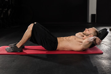 Man Doing Crunches Exercise With Weight
