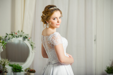 Beautiful bride before wedding ceremony in appartament