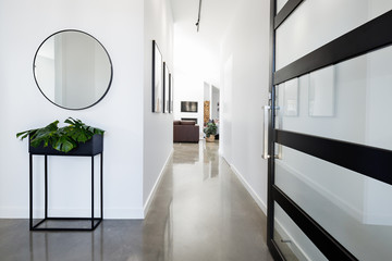 Fototapeta Contemporary home entry with polished concrete floors