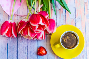 Still life with tulips on the wooden background