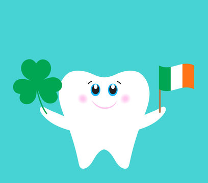 Cute cartoon tooth holding a Shamrock and flag of Ireland