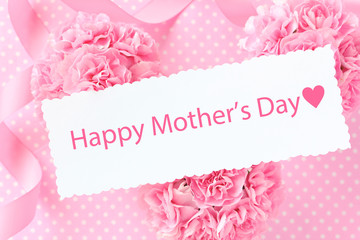 Happy mother's day card on Pink carnation bouquet with pink ribbon