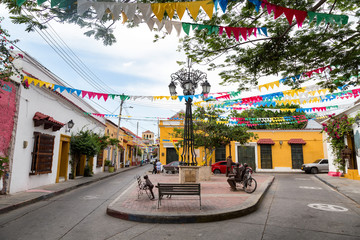 View of a small colorful plaza tucked away in the Getsemani neighborhood of Cartagena, Colombia.