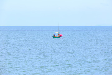 alone or single boat of fisherman on the sea or ocean.