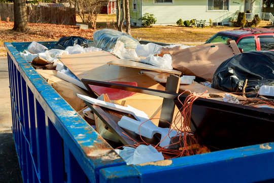 Over flowing Dumpsters being full with garbage