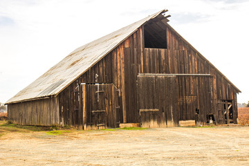 Abandoned Wood Barn With Tin roof