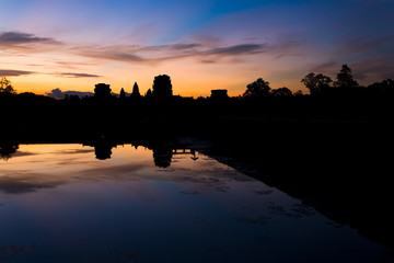 Angkor Wat Temple Silhouette Morning Sunrise Water Reflection in Cambodia