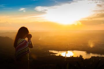 Girl praying on the Mount, thank God.