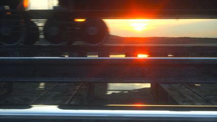 Freight train oil tankers. Against Sunrise. 3d rendering.