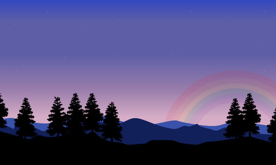 Spruce on the hill with rainbow landscape