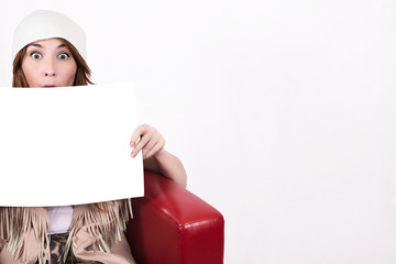 fashion brunette girl in a cap and trendy round sunglasses with white card